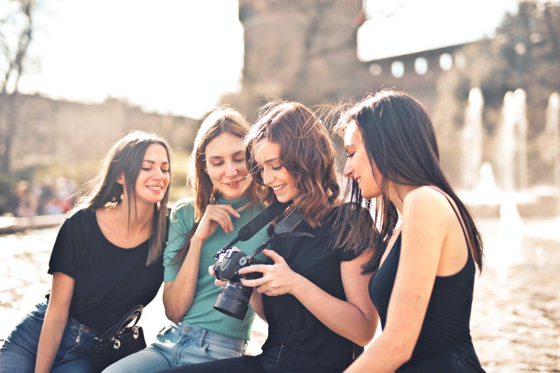 group of girls gathered around best budget digital camera