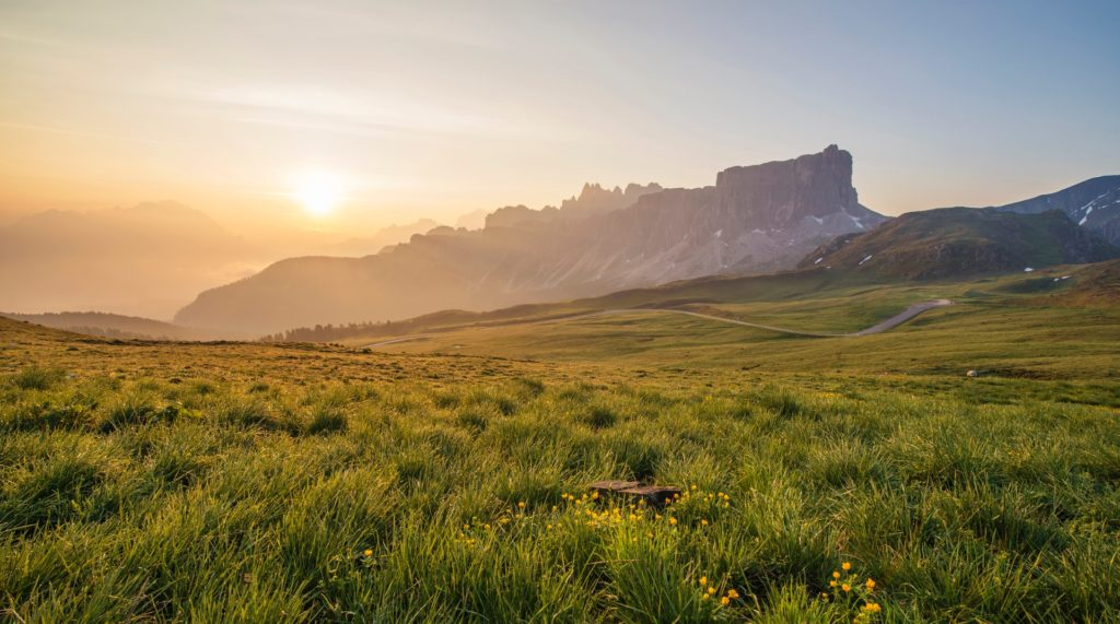 landscape shot with uneven ground and mountainous region, sunrise